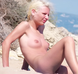 On a relaxing day a gorgeous nudist sunbathes